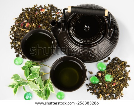Tea set on white background - stock photo