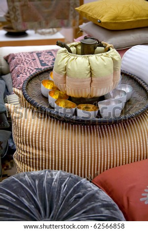 tea set with pillows designed in Marrakesh style - stock photo