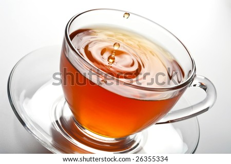 tea splash in glass cup - stock photo