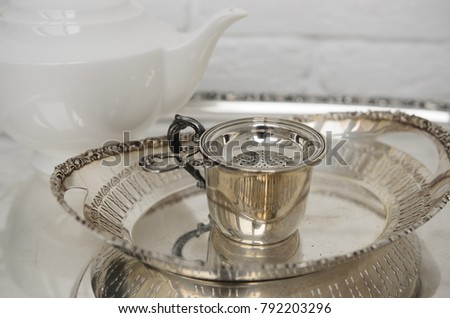 Tea time for royal people. Vintage silver plate sieve for tea, antique for shop or restaurant