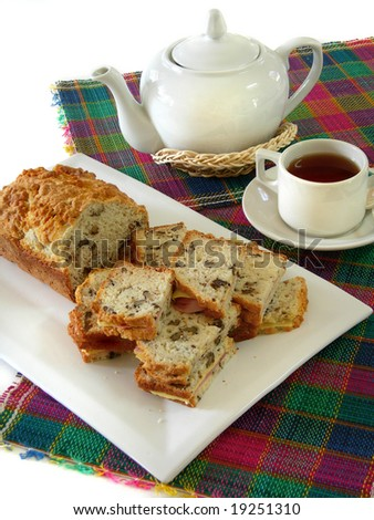 Tea with bread of nuts sandwich on white background - stock photo