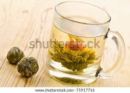 tea with flower on wooden table - stock photo