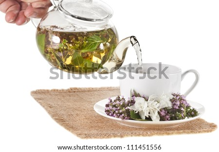 tea with fresh fragrant aromatic herbs  isolated on white background - stock photo