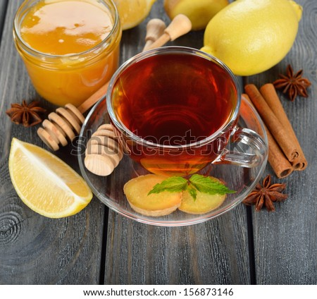 Tea with ginger on a gray table - stock photo