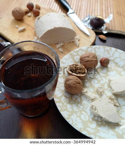 Tea with halva and nuts