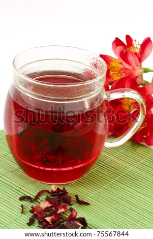 Tea with Hibiscus on a green background