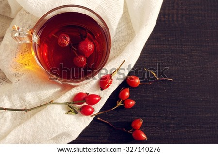 Tea with rosehip on a table. Useful drink for health. Herbal tea. Traditional medicine. Top view - stock photo