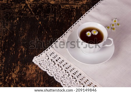 tea with sugar and white flowers, soothing tea, retro - stock photo