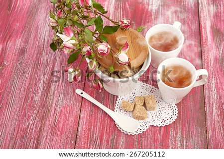 tea with sugar cubes on wooden - stock photo