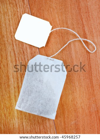 Teabag with a white tag closeup - stock photo
