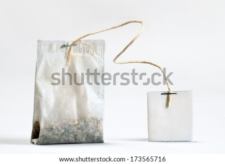 Teabag with white label. Isolated on white background. - stock photo