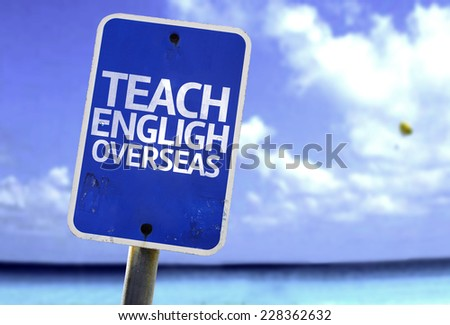 Teach English Overseas sign with a beach on background - stock photo