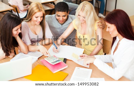 Teacher and her students together in class. - stock photo