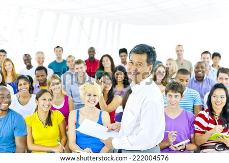 Teacher and large group of student in Lecture room - stock photo