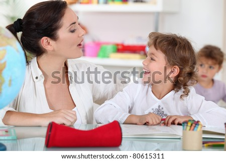Teacher and pupil - stock photo