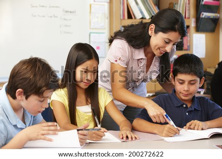 Teacher and schoolchildren in class - stock photo