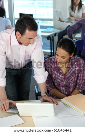Teacher and student - stock photo