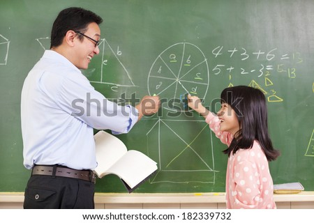 Teacher and student discussing math questions - stock photo
