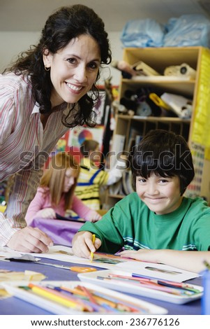 Teacher and Student in Class - stock photo