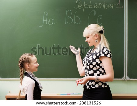 teacher and student in the class - stock photo