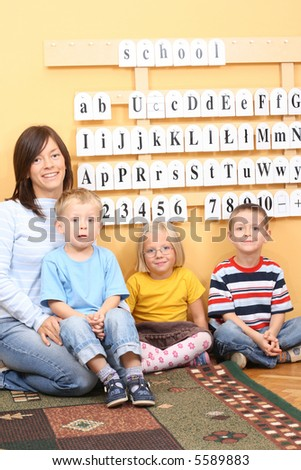 teacher and three preschoolers during lesson