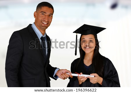 Teacher at school with student who is graduating