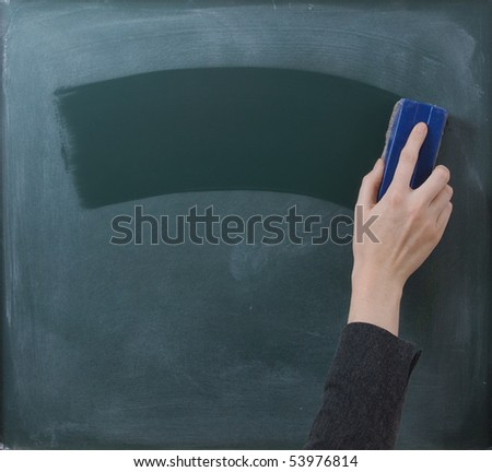Teacher cleaning the chalkboard, suits horizontal composition - stock photo