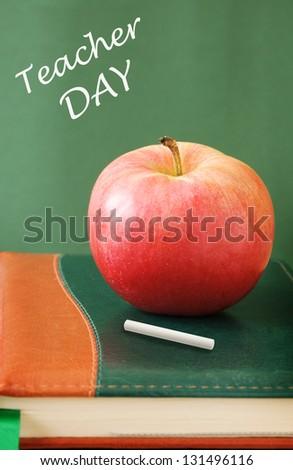 Teacher Day (still life with blackboard,chalk,apple and books) - stock photo