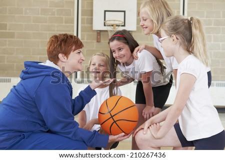 Teacher Giving Team Talk To School Basketball Team - stock photo