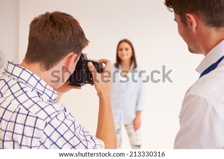 Teacher Helping College Students Studying Photography - stock photo