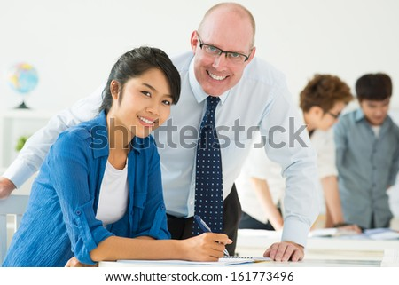 Teacher helping his student - stock photo