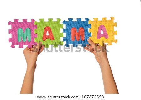 teacher holding in the hand the amusing colored educational puzzles with the word mama