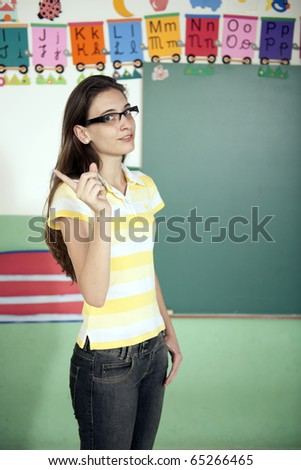 Teacher in front of blackboard - stock photo