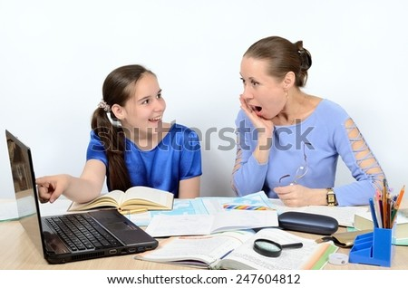 Teacher is surprised by result of work schoolgirl on a computer - stock photo