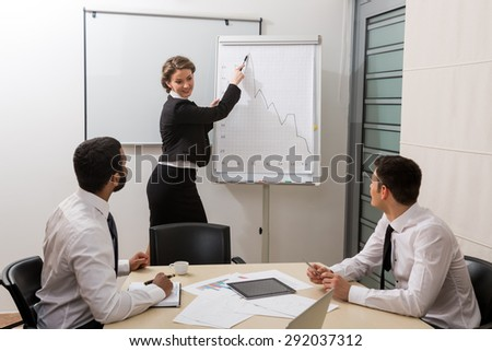 Teacher is teaching the students.Business training for students.  - stock photo