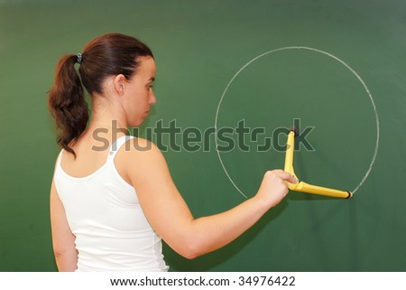 teacher on the blackboard to draw a circle