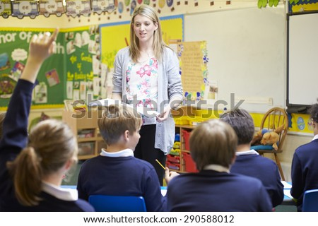 Teacher Teaching Lesson To Elementary School Pupils - stock photo