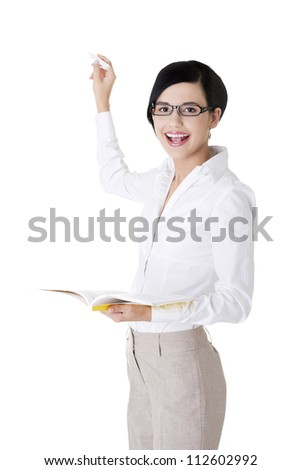 Teacher with book and chalk in hands presenting something on abstract chalkboard. Isolated on white - stock photo