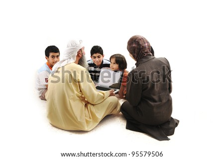 Teacher with children using laptop - stock photo