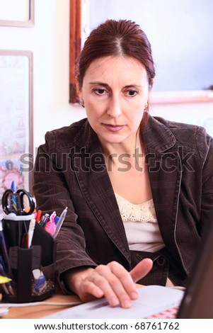 teacher with laptop in classroom . - stock photo