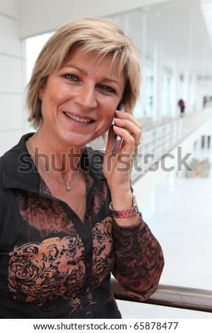 Teacher with mobile phone - stock photo