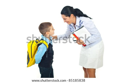 Teacher woman or mother talking with schoolboy isolated on white background - stock photo