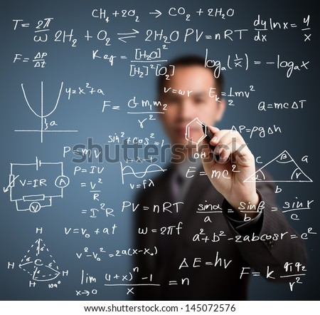 teacher writing high school maths and science formula - stock photo