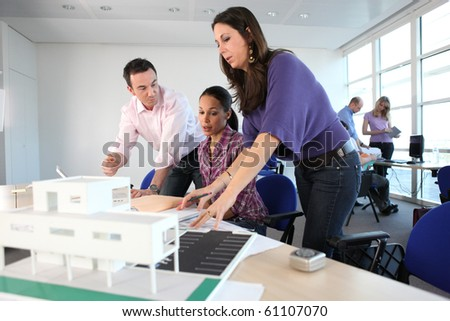 Teachers and student in architecture - stock photo