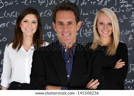 Teachers at school in the classroom ready for work - stock photo