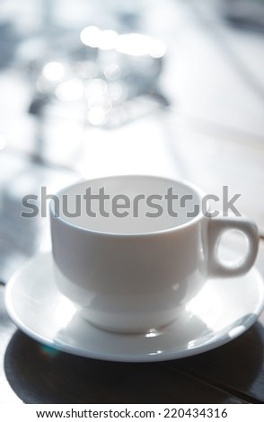 Teacup on the table at outdoors cafe - stock photo