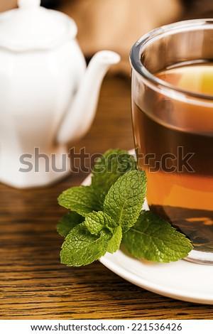Teacup with fresh green tea  - stock photo