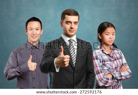 Team and lamp head business people with man shows well done - stock photo