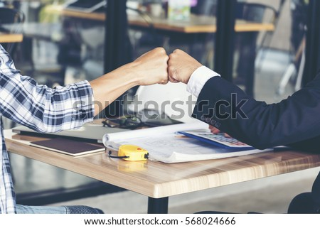 Team Business Partners Giving Fist Bump to Greeting Start up project with Contractor. Corporate Teamwork Partnership in an Office Meeting. Businessman with Hands together. Industry Business Concept.