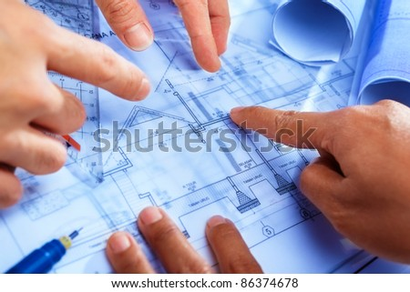 Team discussing detail on the home blue print design